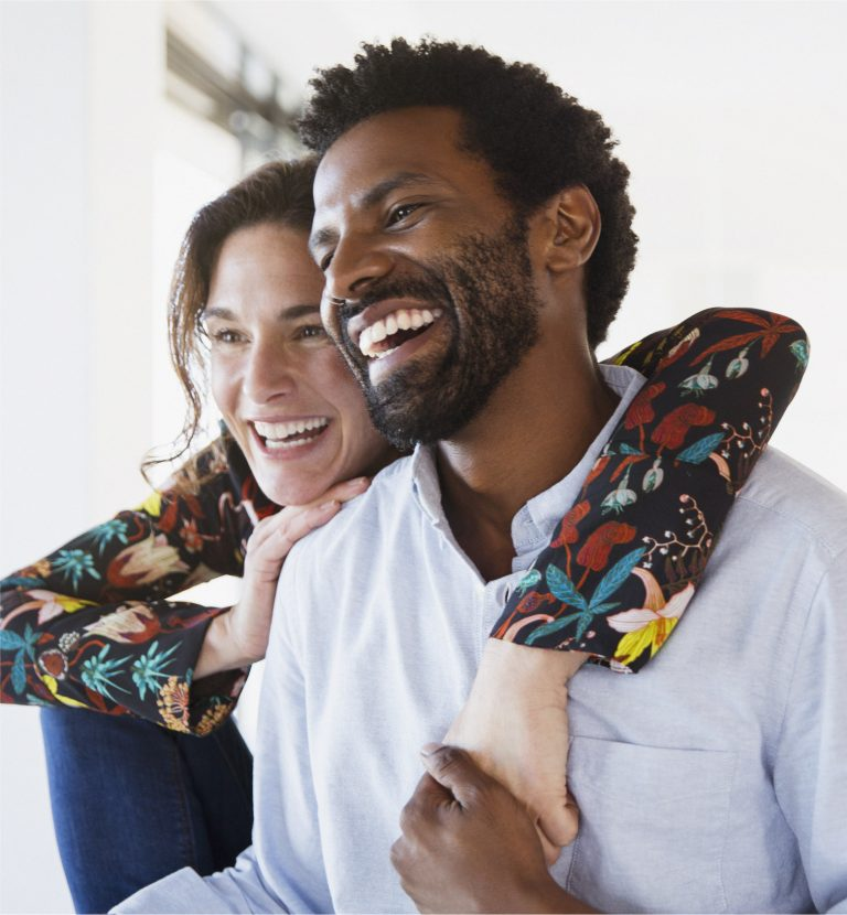 Image of a couple laughing.