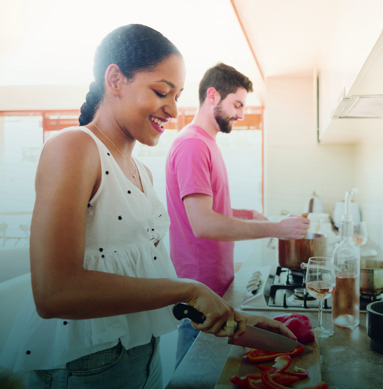 Image of two people cooking.